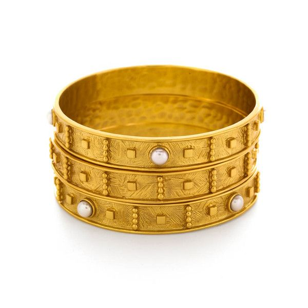 Detailed carving and cabochon stones rise up from the cross hatch plane of this elegant bangle. - 24K gold plate - Semi-precious stones or shell pearl - 3/8th inch width - Available in Small & Medium