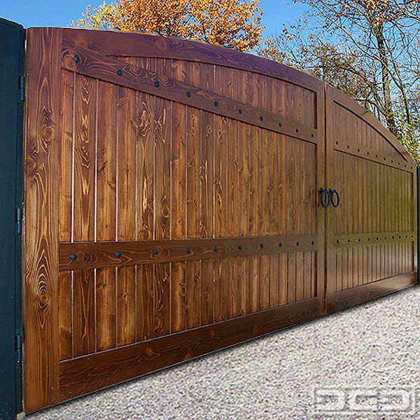 Dynamic Garage Door | Custom Motorized Driveway Gates : Architectural Gates-in darker stain.