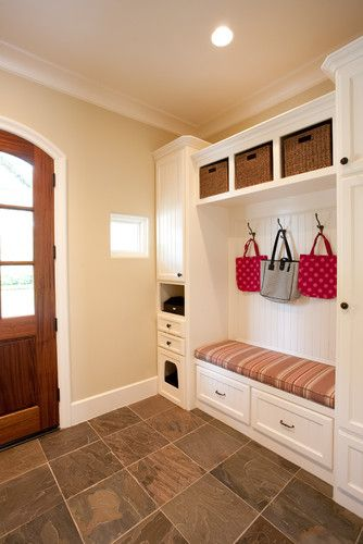 Beadboard with hooks, seating, storage space, custom cubby for kitty litter box. Underbench storage would be better as shelving for shoes.
