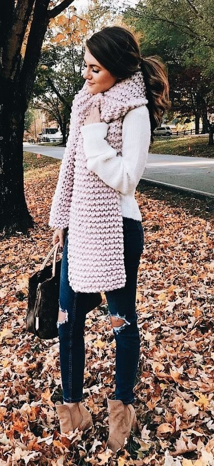 White top with navy jeans and cozy gray scarf.