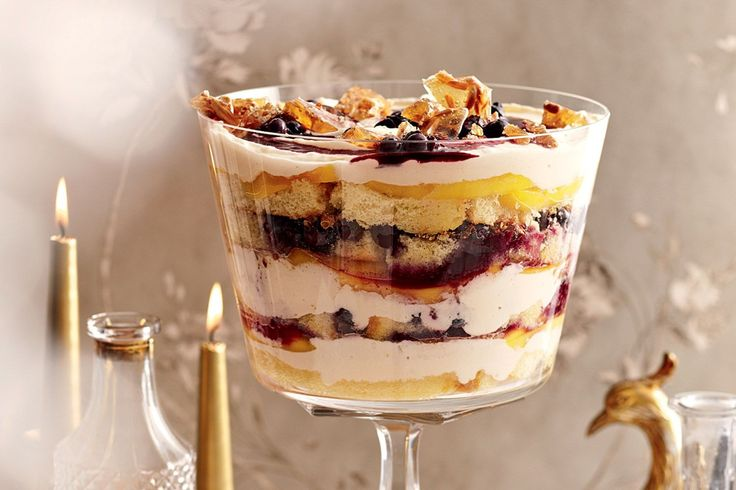 This trifle is a perfect combination of fresh berries and sweet mango, but it can be made with any seasonal fruit. Top with praline for crunch.