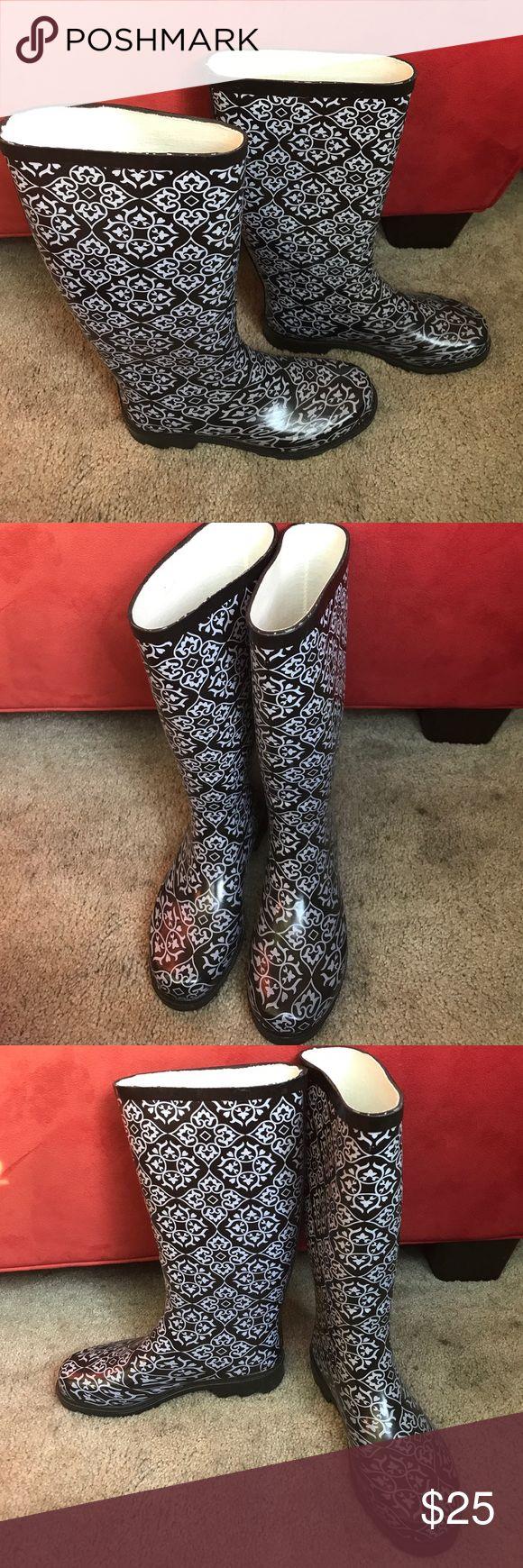 Rasolli size 8 rain boots/wellies/galoshes Cute pair of Rasolli brand rubber rain boots/wellies for sale! Women's size 8, black with grayish paisley pattern, worn only twice. Very sturdy waterproof galoshes. Rasolli Shoes Winter & Rain Boots