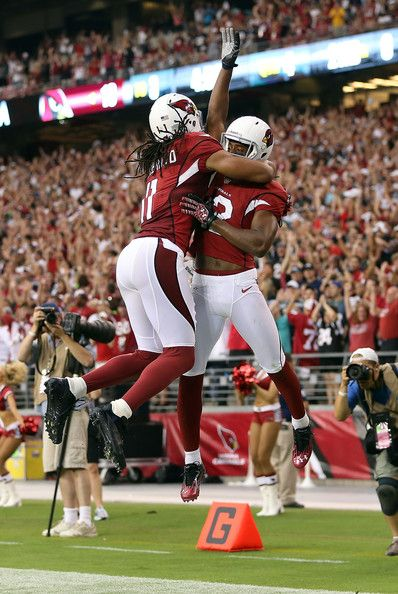 Wide receiver Andre Roberts #12 of the Arizona Cardinals celebrates with wide receiver Larry Fitzgerald #11 after scoring a 6 yard touchdown reception against the Seattle Seahawks during the fourth quarter of the season opener at the University of Phoenix Stadium on September 9, 2012 in Glendale, Arizona.