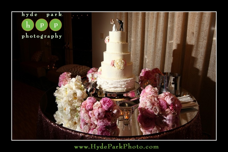 A mirror topped the pink sequin linen on this cake table for the couple's wedding reception at the Four Seasons Hotel in Downtown Austin, TX. Photo by Austin wedding photographers, Hyde Park Photography. www.HydeParkPhotography.com