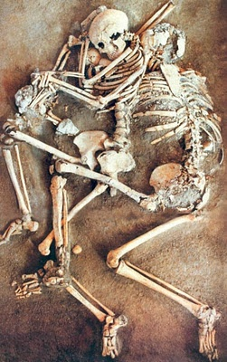 Family killed in earthquake 365 A.D. Mother is protecting child. Father protecting them both.