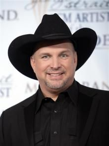 BOYCOTT THIS BASTARDS COME BACK! SEND HIS ASS BACK WHERE HE'S BEEN HIDING!! FUCK YOU GARTH HOPE YOU HAVE FUN WITH THE DIXIE CHICS!! Garth Brooks on Obama: I Love Him to Death; It's Got to Be Hell In That Office | CNS News