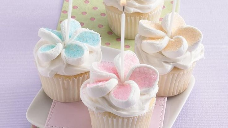 Celebrate a birthday with easy-to-make cupcakes. A simple snip of a marshmallow makes the decoration.