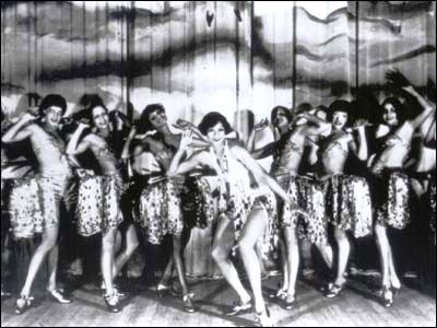 "Hot Steppers at the Cotton Club. ""The Cotton Club was known for supporting black stereotypes, by providing animalistic costumes to the dancers and creating oppressive segregation in the club. The dancers at the nightclub were hired under austere and prejudiced standards. They had to be at least 5 feet, 6 inches, light-skinned, and below the age of 21."""