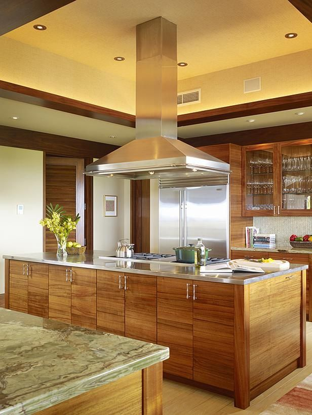 15 best images about free standing range hoods on for Kitchens with islands in the middle