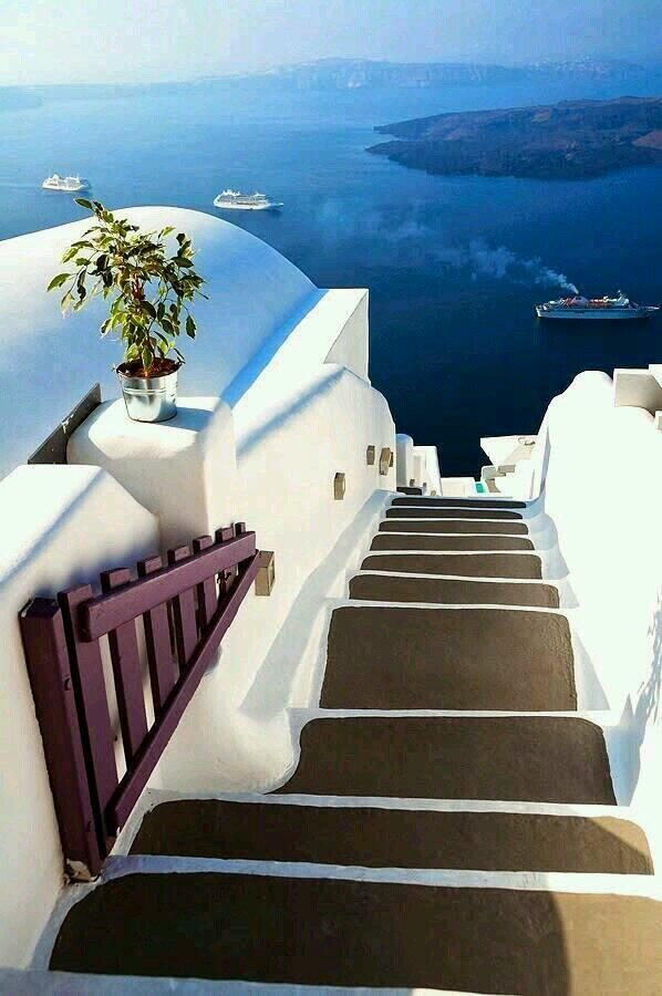 Santorini, Greece. Now that's living it up.... Big glasses white and Gold bathing suit. Oh yeah!!!