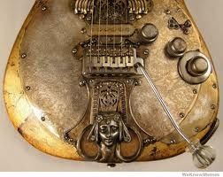 This is a fantastic guitar mod with a glass nob on the end of the whammy bar and the face near the pickups. Would live to steampunk out a guitar to have on display and to play in the livingroom.