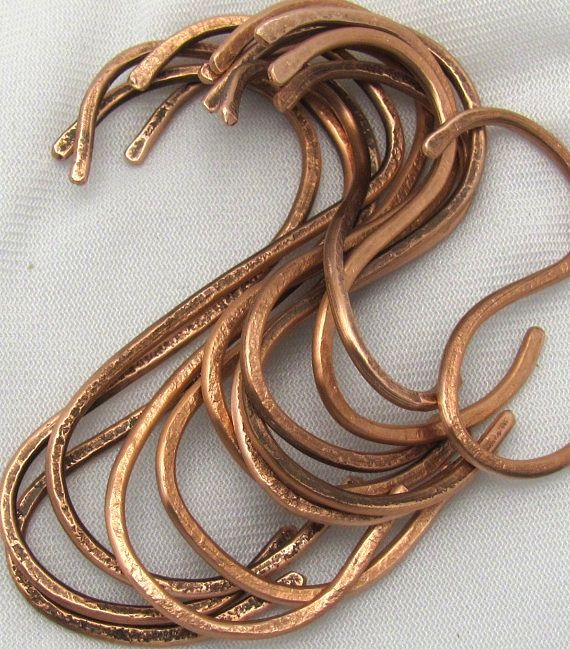 Above: A set of 12 Hand-Hammered Copper Pot Rack S Hooks is $21.99 from Ruddle Cottage on Etsy. A dozen S Shaped Pot Rack Hooks in copper from the Metal Peddler is $20.95.