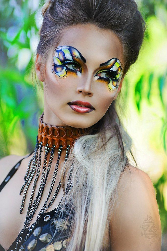 Artistic yellow, red, white and brown fantasy makeup mask with gem accents by Zolotashko Make Up School.