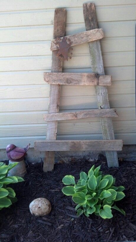 Made from old fence boards :) Use pallets similar to this for towel rail.