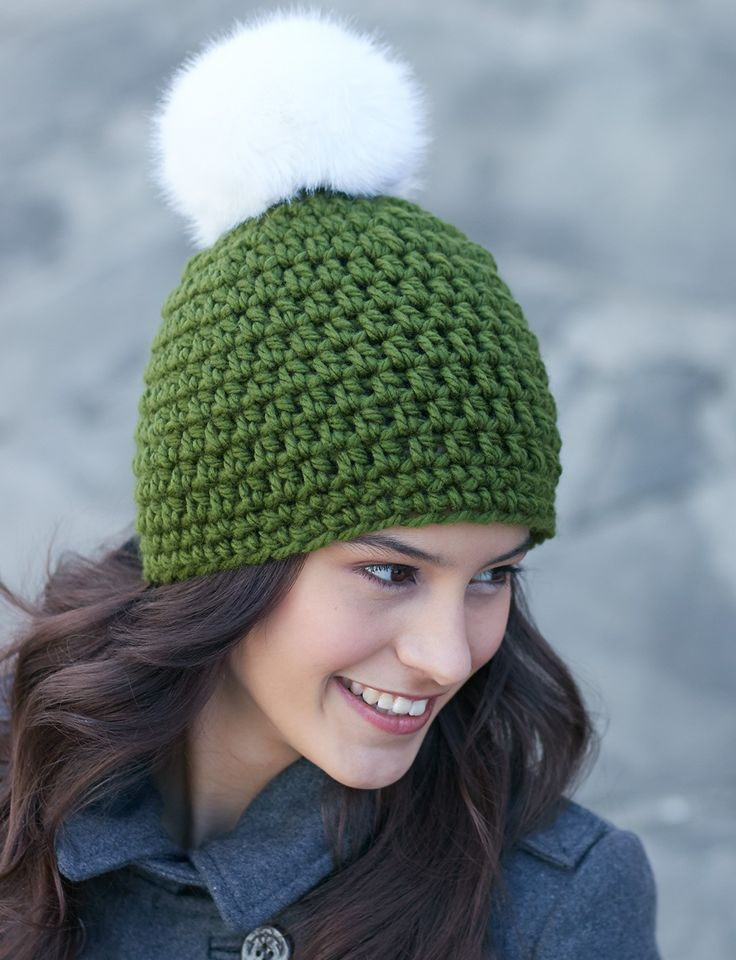 Quick and easy crochet hat topped with a fun faux fur pompom: #free #crochet #hat #pattern: