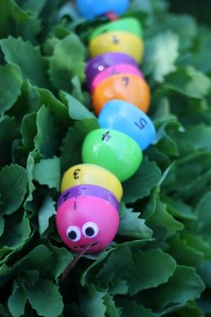 Number Snake Threading with Plastic Easter Eggs!  Great for fine motor development and number recognition!