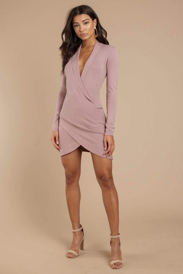 89dc1a1c2ac Get wrapped up in the Not Alone Wrap Sweater Dress. This warm Mauve sweater  mini dress features a sexy plunging v-neckline that leads to a chic wrap b  ...