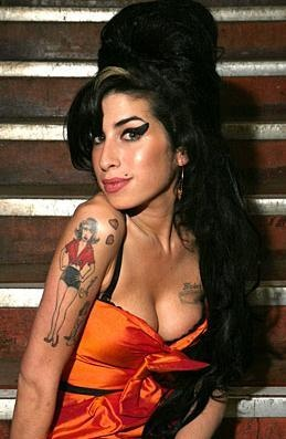 Amy Winehouse... this woman was given an amazing voice and too bad she lost herself in the world of drugs and alcohol.  I really loved her voice!