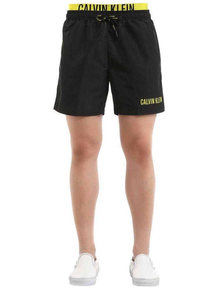 CALVIN KLEIN UNDERWEAR DOUBLE WAISTBAND LOGO SWIM SHORTS. #calvinkleinunderwear #cloth #