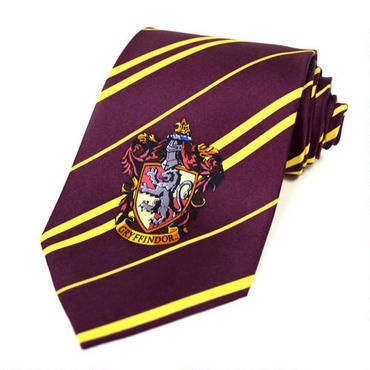 This wonderful Gryffindor tie is based on the one worn by Harry and his Gryffindor friends Ron Weasley and Hermione Granger in the Harry Potter movies. This scarlet and gold 100% silk tie is 56 inches by 3.8 inches. In addition, the tie has a beautiful Gryffindor house logo on one end. For children ages 8 and up as well as adults.