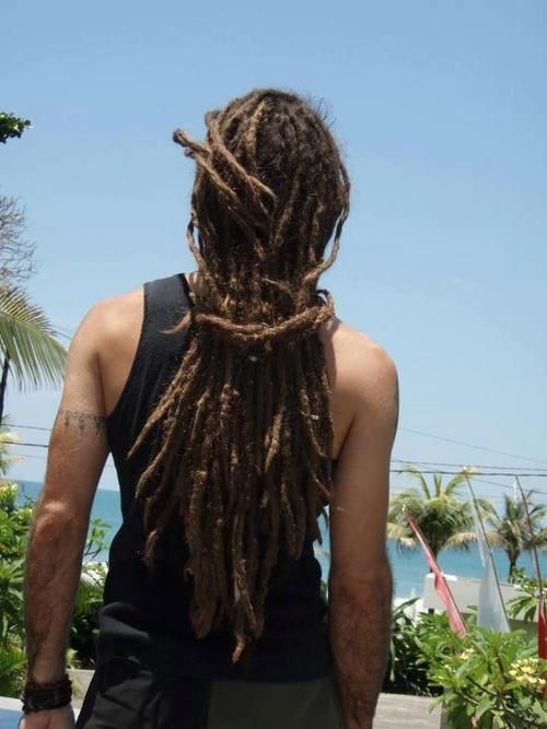 Dread locks always look good on guys. Such a nice angle of this picture.