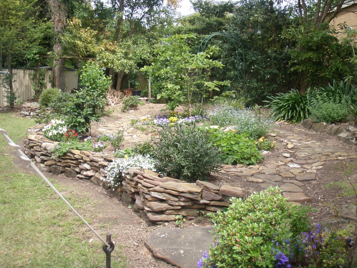 Beautiful Paved Garden With Dry Stone Wall