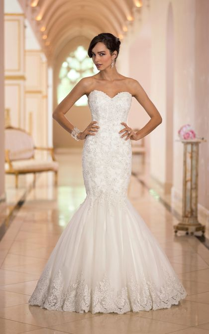 Sophisticated mermaid wedding gown features handcrafted vintage Lace appliques that drop down into a chandelier pattern. Exclusive designer mermaid wedding gown by Stella York.