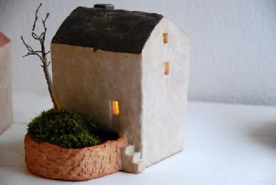 Little ceramic house with mossy side yard