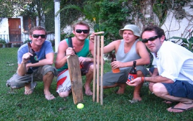 """This photo was taken on Australia day 2008 in Guatemala. My friends and I are all huge fans of summer backyard cricket and beers. Unfortunately we couldn't just duck out and grab a bat so we found the local timber mill and had them fashion a makeshift cricket bat and stumps. No doubt Guatemala will have young rising cricket stars as a result from this infamous backyard cricket match.    See you at the SCG."" Tim"