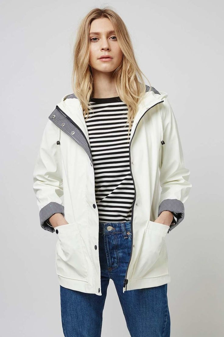 15 Cute Raincoats to Keep You Dry This Spring-Best Raincoats for Women Spring-A NOT-SO-BORING NEUTRAL-A striped lining combined with a modern black zipper help to add interest to this classic white silhouette. White Rain Mac,$100; topshop.com. Check out our selection of spring jackets at redbookmag.com.