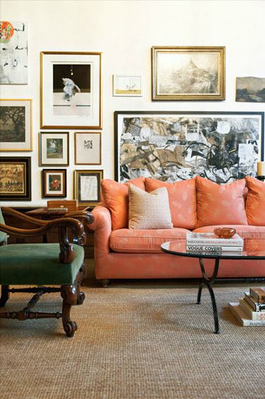 Sitting Space Has Orange Sofa W Subtle Pattern Green Chair Grass Rug And Art Grouping