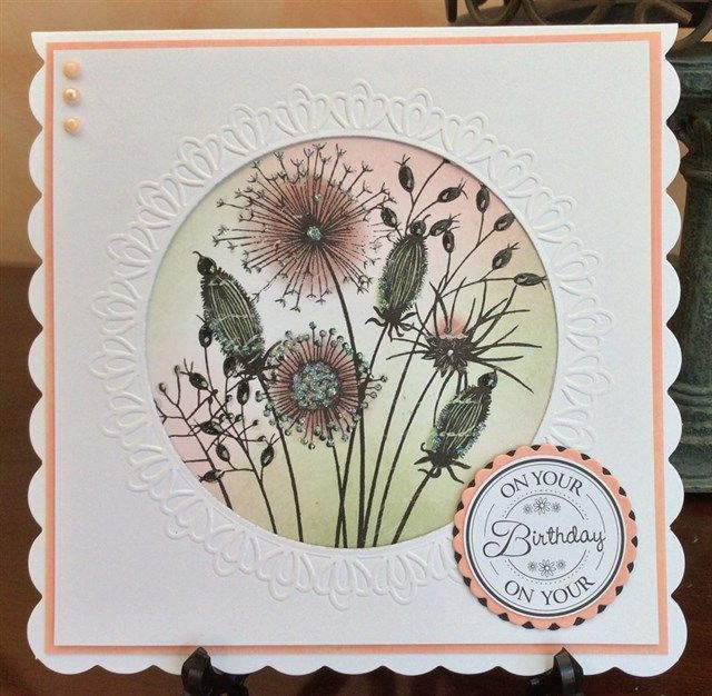 Busier than I care for but I like the delicate coloring.  Woodware Going to Seed stamp set.  Background colored with distress inks.