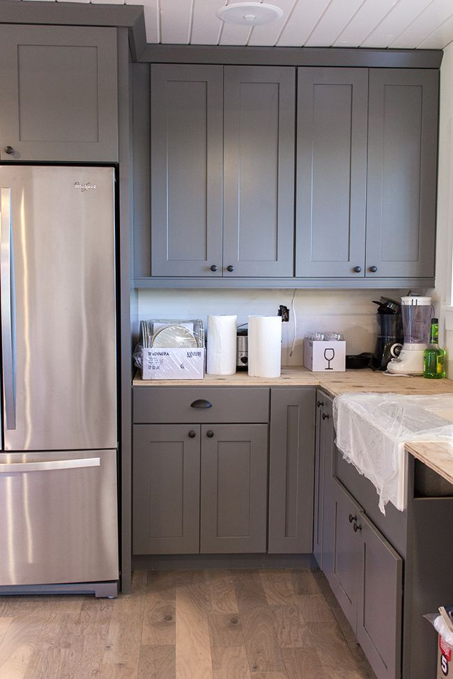Pair gray cabinets with warm colors and materials for Charcoal gray kitchen cabinets