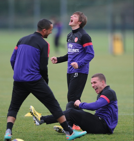 Theo Walcott, Andrei Arshavin and Lukas Podolski at London Colney (December 2012) by Stuart MacFarlane