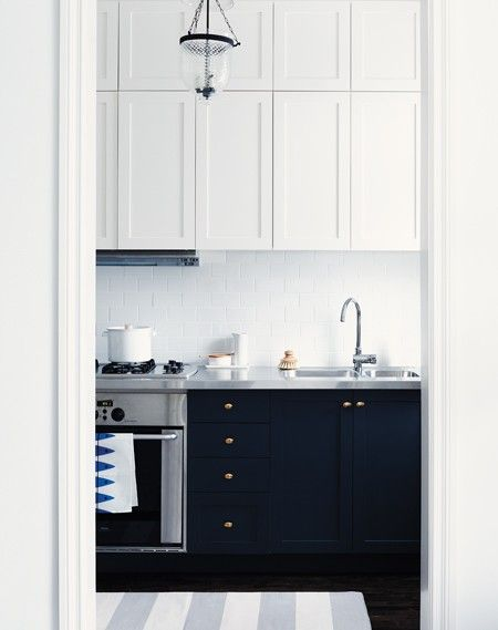 House & Home Kitchens & Baths 2011 issue. Suzanne Dimma's Tiny Kitchen. Light cabinets on top, dark below. just love the black cabinets