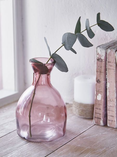 This lovely rose blush glass vase is a lovely addition to any table.