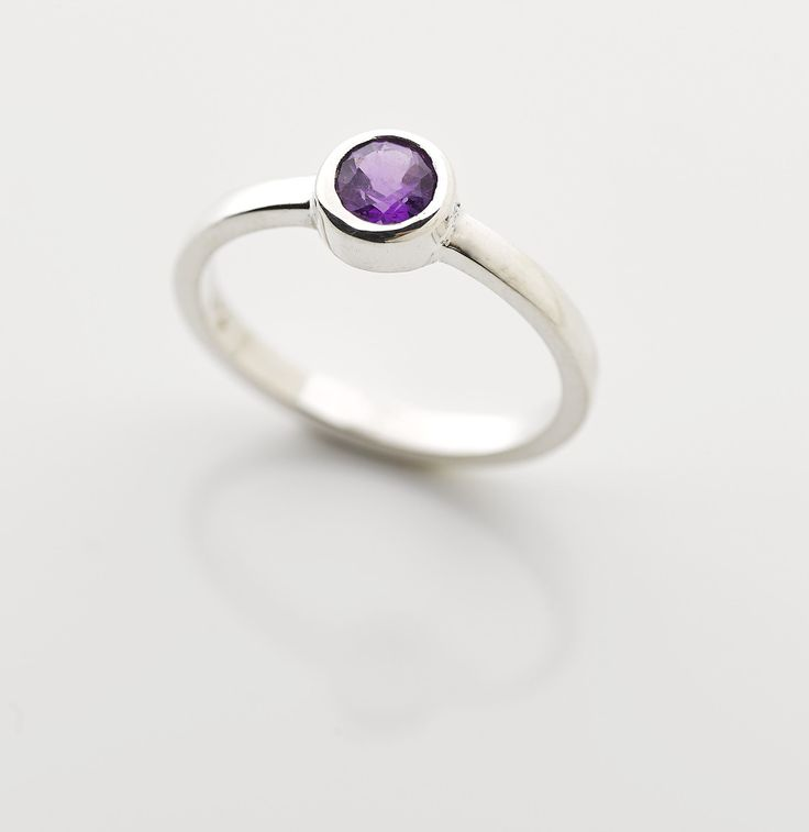 Small round Amethyst set in a sterling silver band