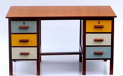 i am quite liking multi coloured painted drawers on timber furniture