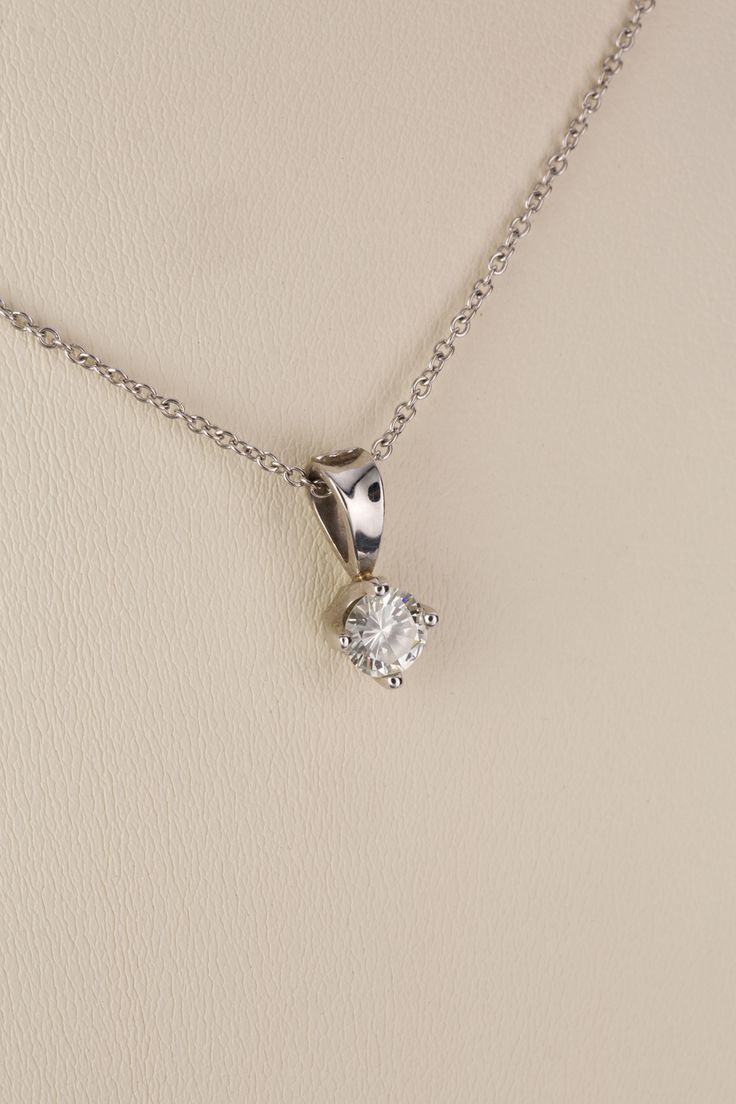 Solitaire style pendant with four claw setting featuring a modern brilliant cut diamond, H/I Colour, VS1 clarity, estimated weight of 0.52cts. Stamped 18ct white gold. Jewellery that lends itself to everyday wear is a wonderful way to express your individual style.