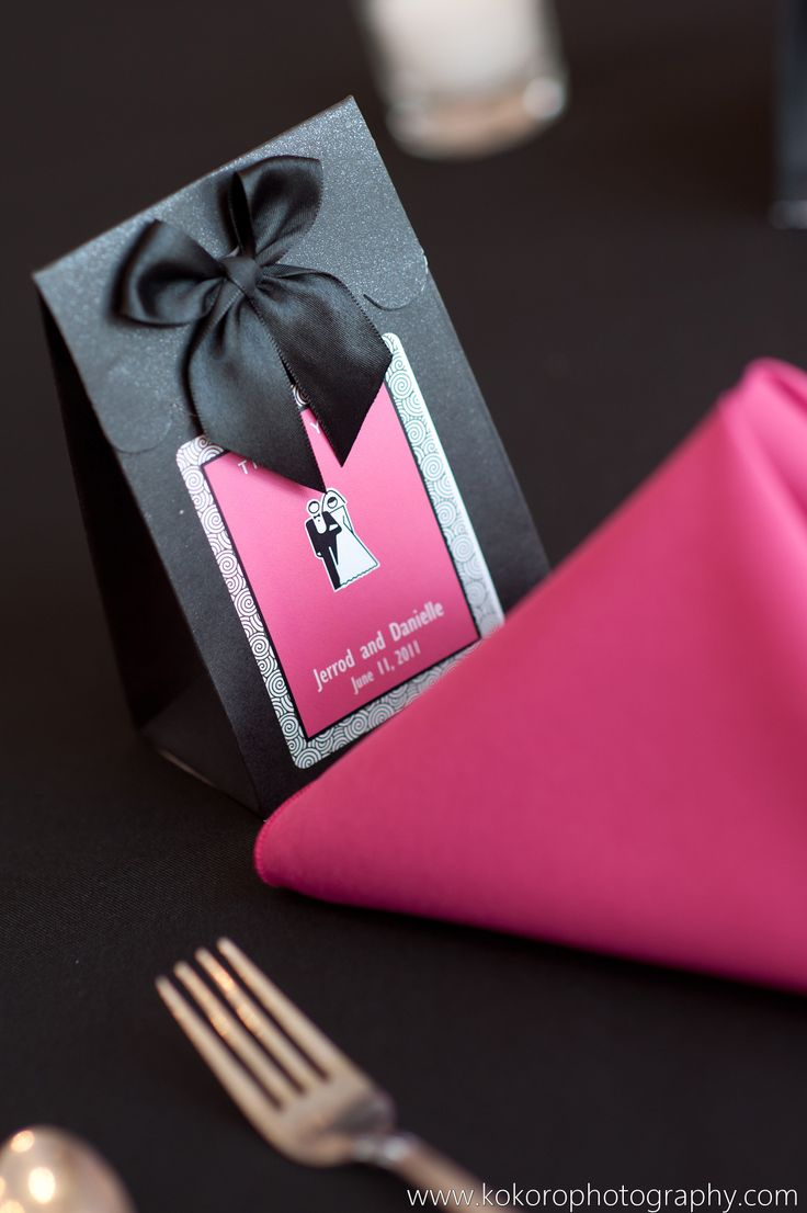 Pink and Black favor boxes at the head of each place setting. Wedding Planning by MuseEvents.com