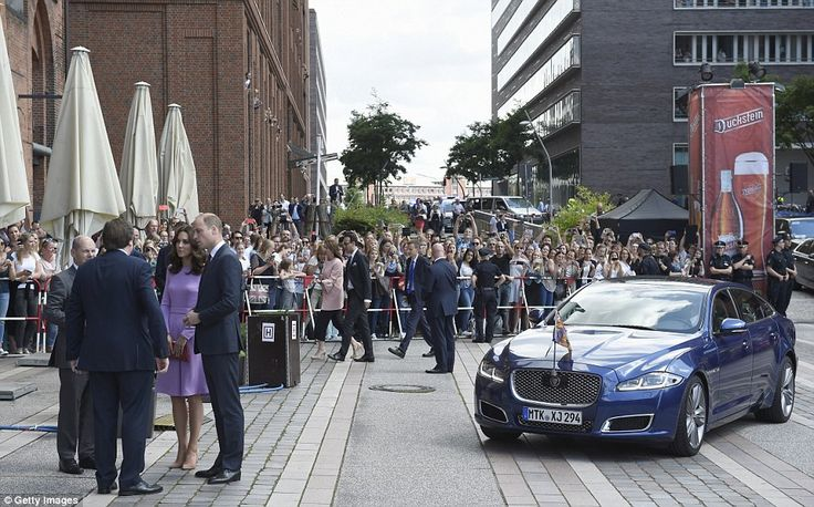 The Duke and Duchess of Cambridge are greeted by Hamburg Mayor Olaf Scholz (left) and Pete...