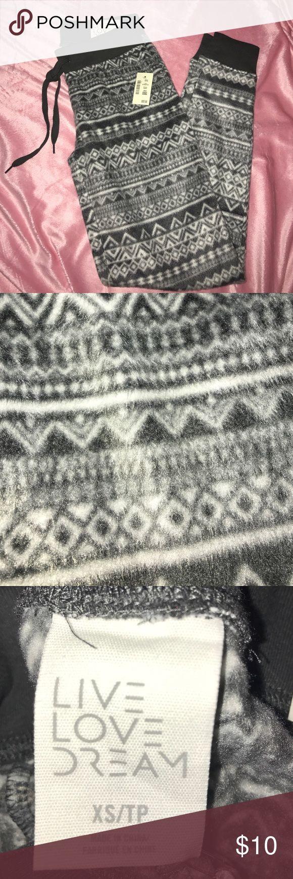 Fleece Joggers Grey and white tribal printed fleece pajama/jogger pants, super soft, never worn Intimates & Sleepwear Pajamas