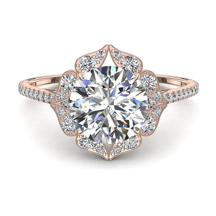Bague de fiançailles solitaire diamant rond de 1,10 carats or rose Arina  Arina, belle bague de fiançailles diamant rond or rose de 1,10 carats. Cette bague diamant or rose est sertie d'un diamant central de 0,50 carats. La particularité de ce bijou est son plateau sertie de diamants de différente tailles et qui lui donne un aspect tout à fait unique. Cette belle bague de fiançailles diamant que nous fabriquons dans nos ateliers est montée sur de l'or blanc, jaune ou rose 18 carats selon…