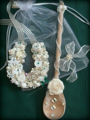 Horseshoe and wooden spoon lucky charm keepsake for a bride on her wedding day.