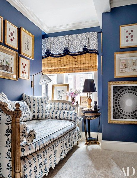 Painted a Benjamin Moore blue, the guest room of Alexa Hampton's New York City family home features a Louis XVI daybed upholstered in a Les Indiennes fabric.