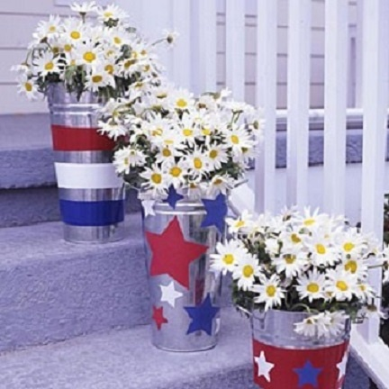 Stencil stars and stripes on tin cans. They can be large for arrangements, or small to hold silverware!