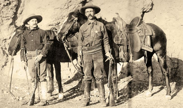 Private Bill Foster wears his Arizona Ranger badge and holds the standard Ranger 1895 Winchester .30-40 lever-action rifle as he stands to the left of Deputy Sheriff Clark Farnsworth in 1903. Two years later, Farnsworth would enlist with the Rangers.