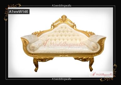 Royal Golden Wedding sofa, best for any special occasion, event and wedding. For booking call us at 7958 330043. #Wedding #AsianWeddingStage #WeddingStages #StageDecoration #AsianWedding