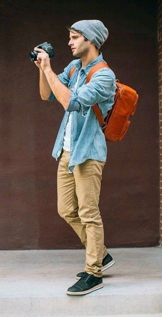 The versatility of a baby blue chambray button-down shirt and khaki chinos makes them investment-worthy pieces. Want to go easy on the shoe front? Go for a pair of black low top sneakers for the day.