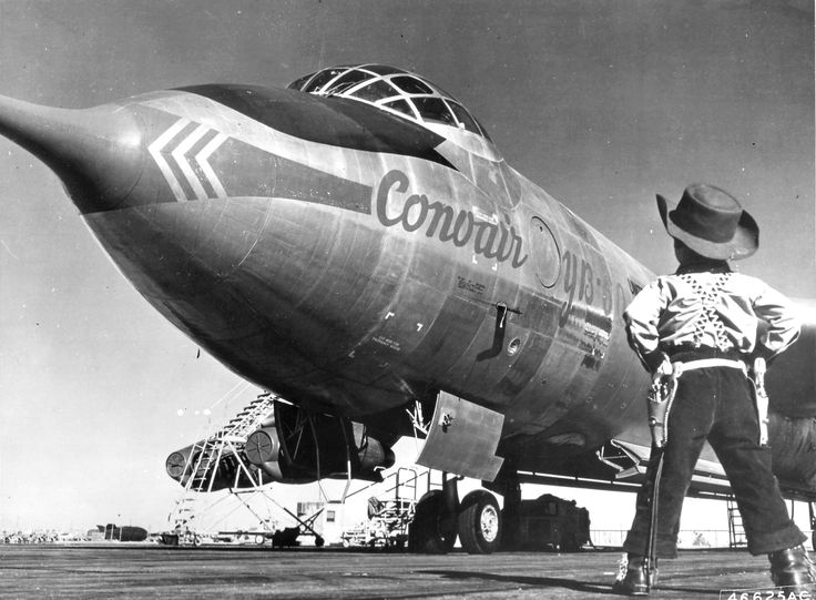 """1950's — A young ""cowboy"", the son of a member of the Air Force Flight Test Center, Edwards Air Force Base, California, looks over the Convair built YB-60 during its visit at Edwards from the Fort Worth, Texas, plant. (1953)"""